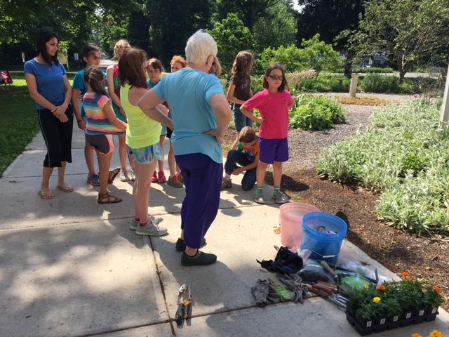 Planting marigolds at the Elizabeth Schroeder Memorial Garden